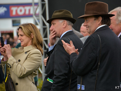Trainers watching Many Clouds enter the parade ring   by Carine06
