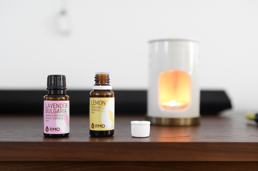 Essential oil diffuser and open bottle of essential oils