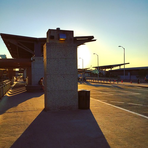 iphoneography sunset evening austin texas atx texascapital sundown bluesky clearsky shade shadows sunlight urbanlandscape ioatx outdoor airport waiting departure arrival perspective lady woman smartphone bergstromairport iphone6 iphonesix