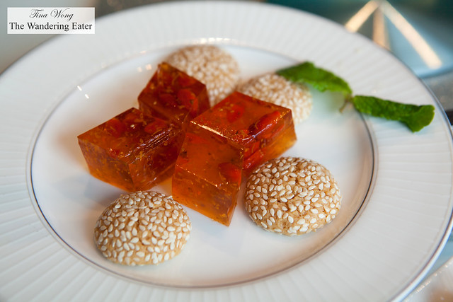 Petit fours of goji and osmanthus tea jellies and sesame cookies