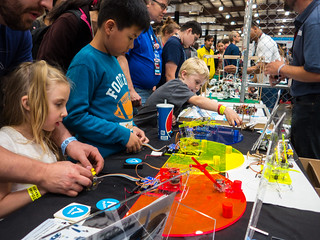 Kids Learning to control a toy robotic arm at Maker Faire 2016 | by donjd2