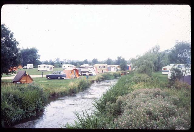 tent and Hillman Husky alongside river