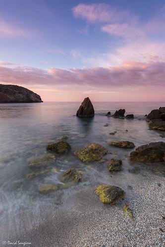 longexposure pink blue sky seascape beach clouds sunrise landscape dawn coast sand rocks stones horizon tripod shoreline murcia cloudscape mazarrón transparentwater canonef1635mmf4lisusm canoneos6d