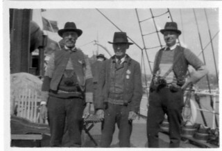 J. E. Taklax, J. P. Ragvals and an unidentified man (Sm 5863)