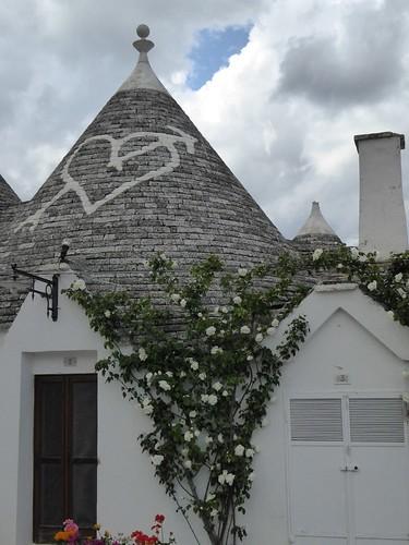 De tekens op het dak en de vorm van het 'eindpuntje' (in dit geval een bolletje) hebben allemaal een andere betekenis ...