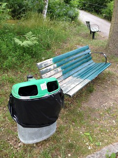 < the trash can is resisting the paint on the bench >   by Mister.Marken