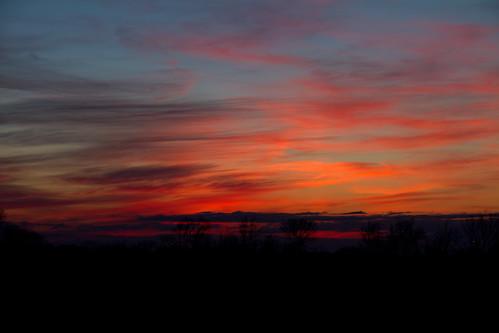 blue sunset red sky orange cloud black patterns
