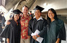 University of Hawaii students athletes, from left, Tasha Miyataki, UH Hilo Athletics Director Patrick Guillen, Ric Yamamoto and Kristen Sawada.