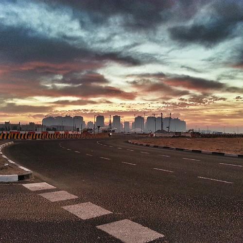 sun mist architecture sunrise square dawn squareformat doha qatar consturction instagramapp uploaded:by=instagram foursquare:venue=4d22ec6a6e8c370487f40fa0
