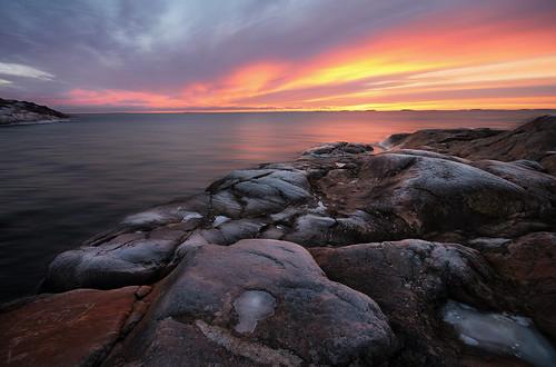 sunset sea seashore seascape ice rocks frost colorful winter water sky suomenlinna horizon helsinki