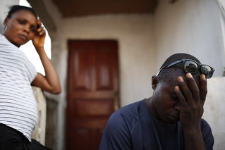 The wife of ebola survivor listens to her husband | by World Bank Photo Collection