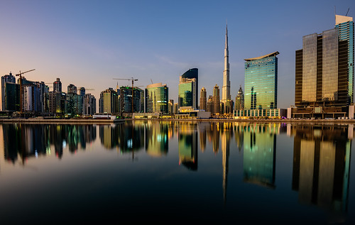 glass east street home beauty panorama structure modern office architecture skyline building sunset landmark facade cityscape vacation property town country construction house high big reflection emirates holiday sea united panoramic mirror reflexion water downtown view business burj landscape urban bay mydubai uae city tower buildings tall sky star middle light luxury steel blue colorful skyscraper beautiful travel hotel gulf scene dubai commercial arabic tourism arab khalifa