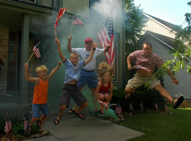 4th of July Smoke Bomb and Flags Family Jump