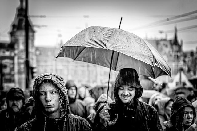 under an umbrella hides the rain