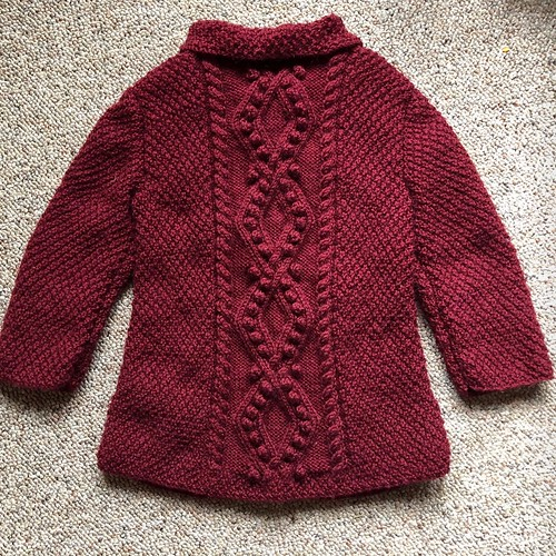 Heather knit this little cardigan for her six year old granddaughter