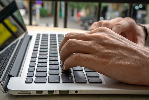 Close Up of Hands on a Laptop Keyboard | by wuestenigel