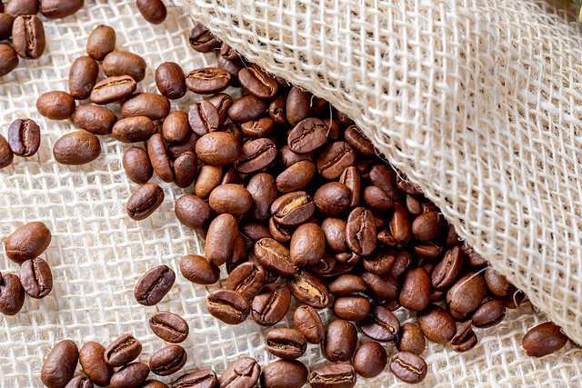 Coffee beans background close up with burlap