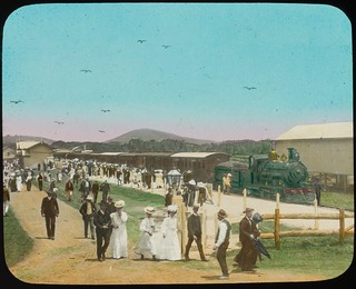 Crowds of people disembarking from a steam train, Queensland, ca. 1910
