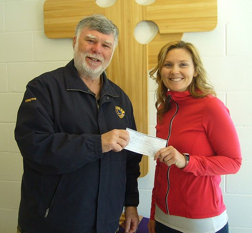 Westport Lions President Wayne Bent presents a cheque to Special Education teacher Nicole Gardhouse.  The money will be used for St. Edward's music program. | by Westport Ontario Lions Club