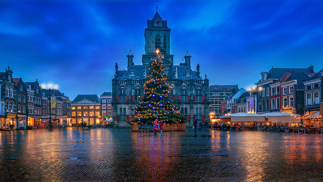 This is the first image I have taken for my 2020 The Netherlands Calendar. Not the best of days,  kinda typical Dutch winter weather. I do love the reflections of this Delft square. The mother with her child in the middle gives the image some more meaning