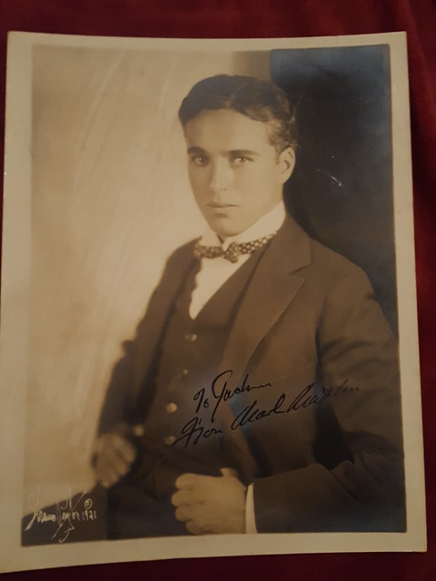 Original signed photo of screen legend Charlie Chaplin, photo taken in 1921 by photographer Strauss Peyton, comedy genius Chaplin had a film career that lasted 75 years. His most famous character was the Tramp which he played from 1914.