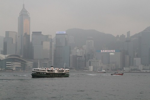 Star Ferry passes a pilot boat off Tsim Sha Tsui