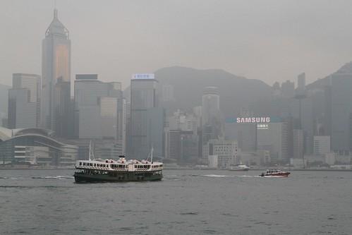 Star Ferry passes a pilot boat off Tsim Sha Tsui