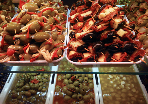 Deli with olive tidbits for sale at Mercado San Miguel in Madrid, Spain