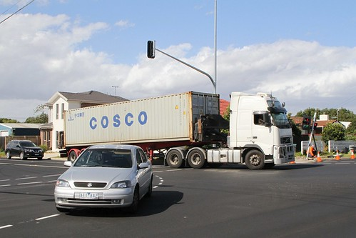 Container truck negotiates the corner of Anderson Road and Wright Street