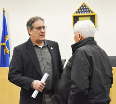 Rep. John Fusco talks with a constituent after hosting a town hall meeting at the John Weichsel Municipal Center.