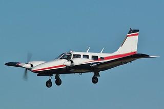 Piper PA-34-200T Seneca II, landing at Kembie - Cotswold Airport .