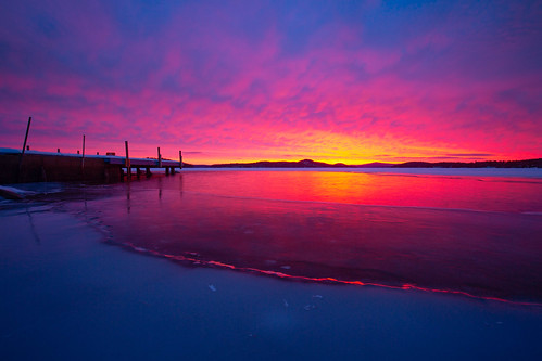 giford granitestate lakelife lakewinnipesaukee nh newengland newhampshire robcliffordphotography cold color colorful dock frozen ice lake lakeice reflection robertcliffordcom shore shoreline snow sun sunrise water winter