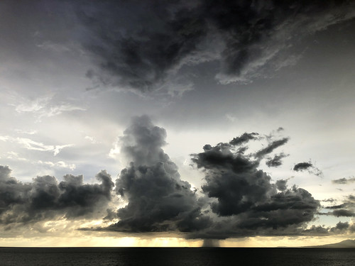 cloud clouds storm stormclouds rain moisture horizon view ocean sunset sunrise sky weather cloudburst precipitation vapor drizzle light lighting sea breeze seabreeze puertovallarta puertovallartamexico mexico downpour