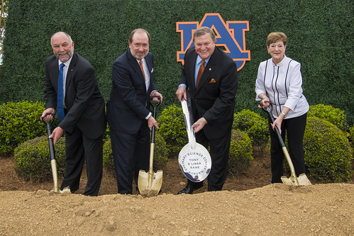 Steven Leath, Raymond Harbert, Jimmy Rane and June Henton hold shovels and dig in dirt.
