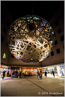 The 'Sphere', a large hanging ball of steel mesh in the Viscardihof | by Micholand