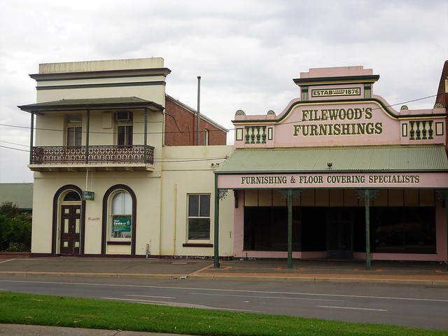 Junee. The west side which was the Crawley private town. On left a solicitors Office with cantilevered balcony built 1885. Next to it a general store built in 1885 for Seigniors but established 1876. .