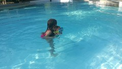 Leah on Hannah's back in pool 3