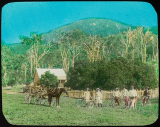 Horsedrawn vehicle and men with pushbikes outside a house, Yeppoon, Queensland, ca. 1910