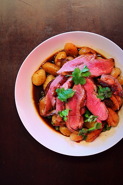 Duck breast with mushrooms broth and gnocchis.