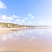 Cotton wool clouds reflected at Gwithian Sands, Cornwall by Zoë Power