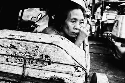 meljoesandiego fuji fujifilm x100f streetphotography tricycle woman candid monochrome philippines
