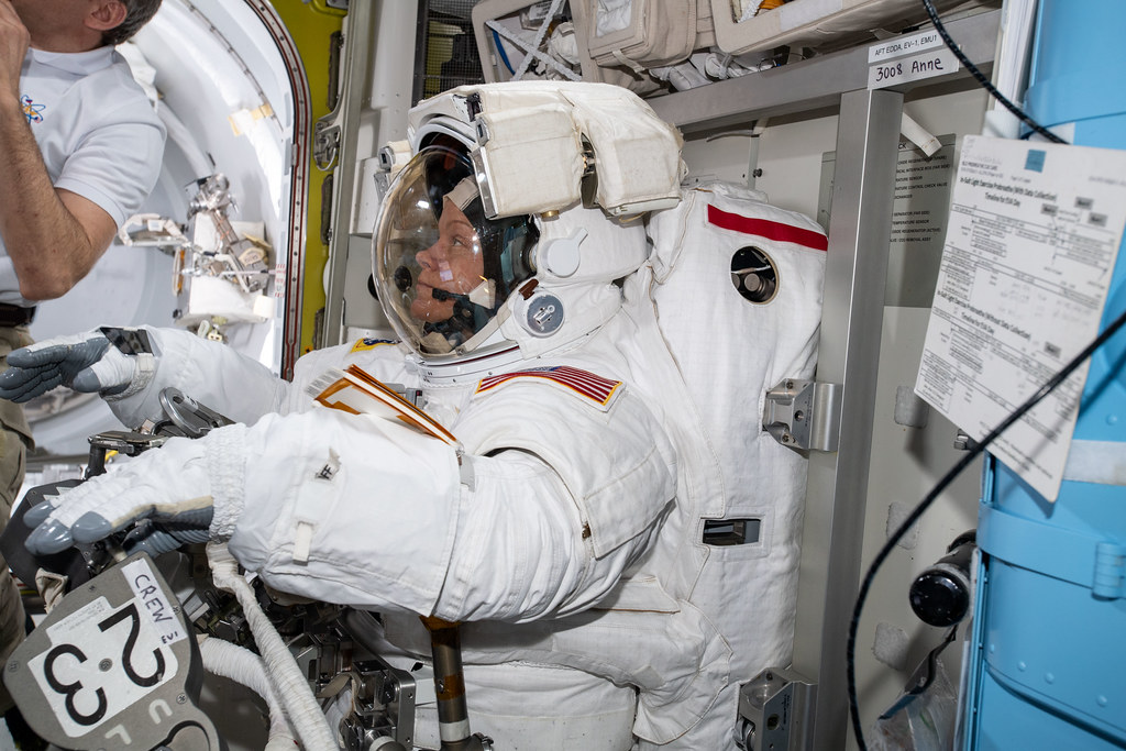 NASA astronaut Anne McClain is suited up in the U S  Quest