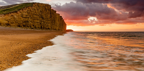 jurassic cliffs land sea sky sand rock stone pebbles person depth perspective sunrise colours canon camera lens landscape seascape