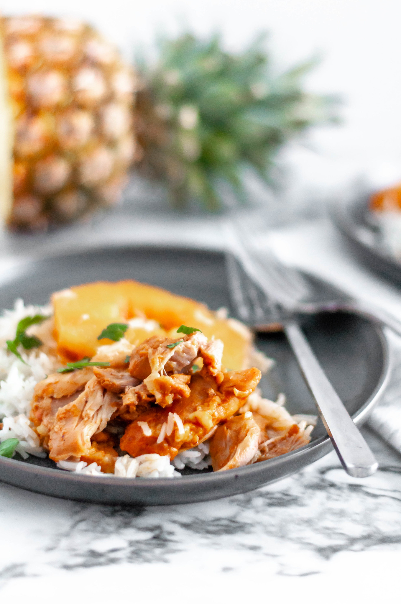 Pineapple BBQ Instant Pot Chicken is packed full of flavor and yields a super tender chicken. Serve over rice for a super simple and quick weeknight meal.