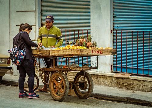 bicycle cart cuba customer fruit oranges peeler pineapple streetphotography streetvendor vendor