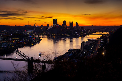 csxpittsburghsub city dawn nsmonline pittsburgh skyline steelcity sunrise backlit beautiful cityskyline dark glint moody orange overlook railroad river steel trains