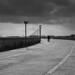 under dark clouds by Brett T