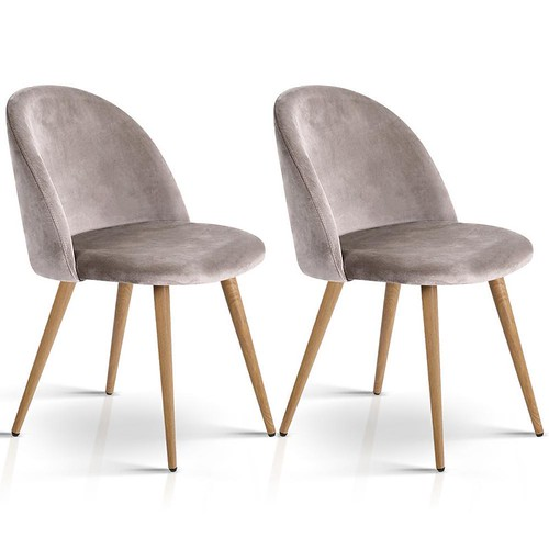 Two taupe suede dining chair with blonde wood legs on a white background.