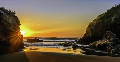 sunrise brighton south island southisland newzealand zealand waves rocks sunray rays morning day photo image picture photos images pictures