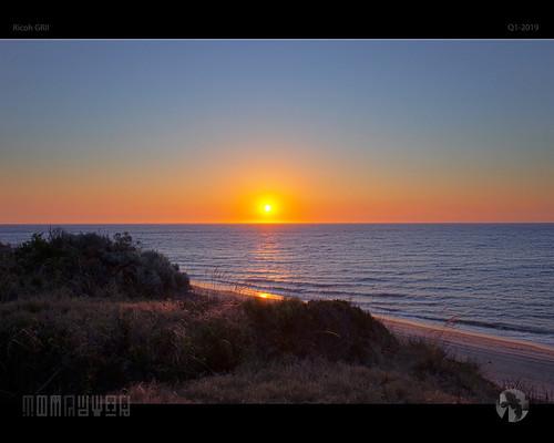 sunset sky sun sea horizon ocean protocol dunes grasses tomraven aravenimage q12019 ricoh grii